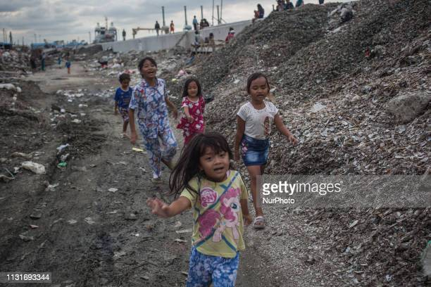 Children are seen playing in slum area Jakarta Indonesia on March 19 2019 Indonesia has around 85 million children or onethird of the national...