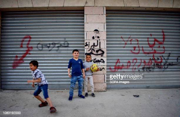 Children are seen playing on the street at the Dheisheh Refugee Camp