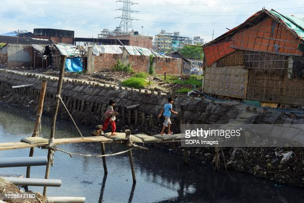 Children are seen walking on a small bridge in the tannery area at Hazaribagh. Most people in this area have become victims of pollution due to the...