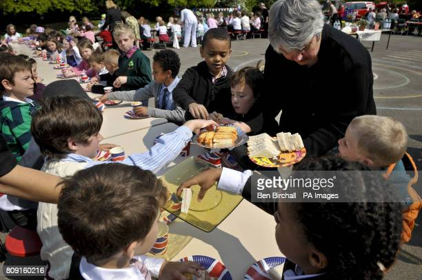 Children are served sandwiches at the Bucklebury Church of England Primary School Royal wedding party in the school playground