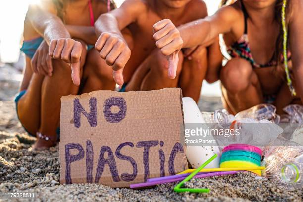children are worried about plastic pollution at the beach - water pollution stock pictures, royalty-free photos & images