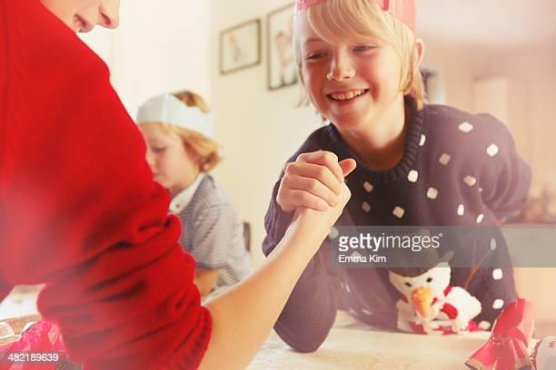 Children arm-wrestling