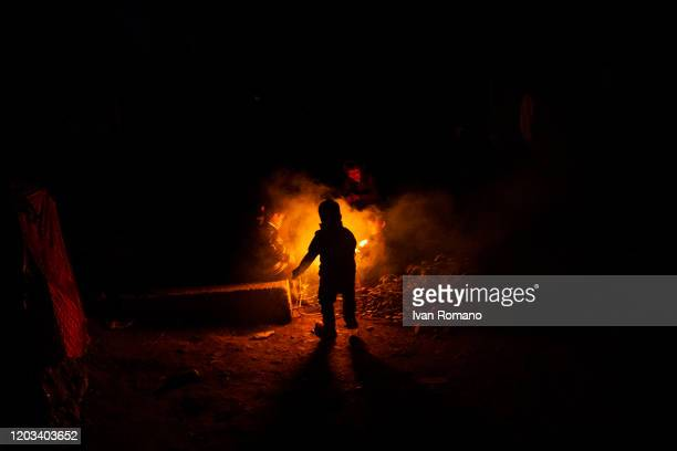 Children around a fire in the Moria refugee camp on January 31, 2020 in Moria,Lesbos Island,Greece. About 19,000 migrants from Afghanistan, Syria and...