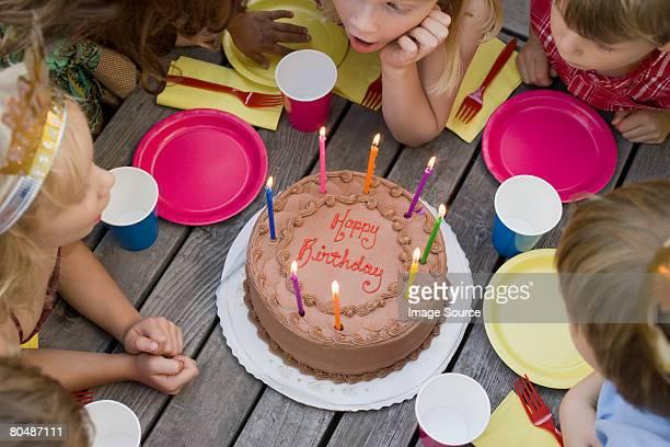 children around birthday cake - 囲む ストックフォトと画像