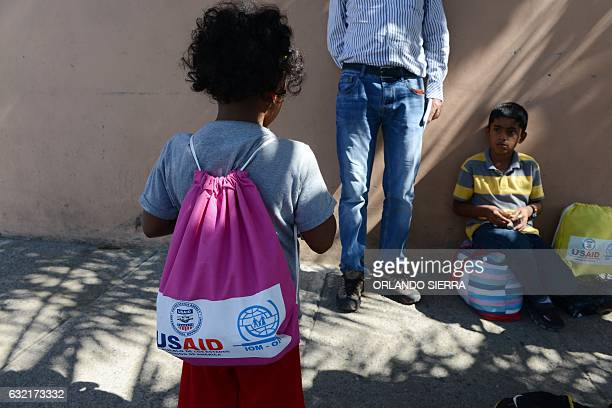 Children arrive deported from Mexico to the city of San Pedro Sula 180 km north of Tegucigalpa on January 18 2017 / AFP / ORLANDO SIERRA