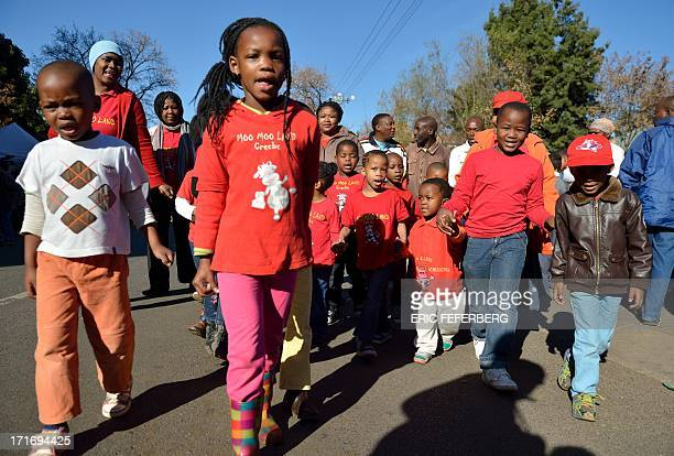 Children arrive to leave messages for Nelson Mandela oustide the Mediclinic Hear hospital on June 28, 2013 in Pretoria. A gravely ill Nelson Mandela...