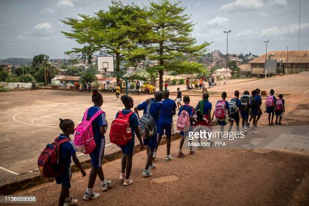 Children arrive to school during FIFA Foundation Community Programme visit on March 17, 2019 in Yaounde, Cameroon.