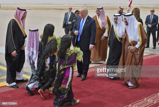 Children arrive with flowers for US President Donald Trump during his welcoming by Saudi Arabia's King Salman bin Abdulaziz alSaud upon Trump's...