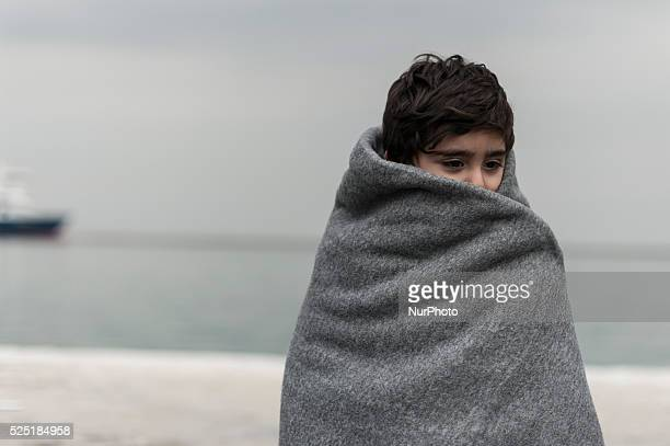 Children as escorted as migrants and refugees arrive on the Greek island of Lesbos while crossing the Aegean Sea from Turkey on March 2 in Mytilene....