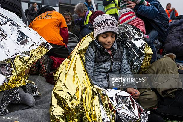 Children as escorted as migrants and refugees arrive on the Greek island of Lesbos while crossing the Aegean Sea from Turkey on March 2 in Mytilene...