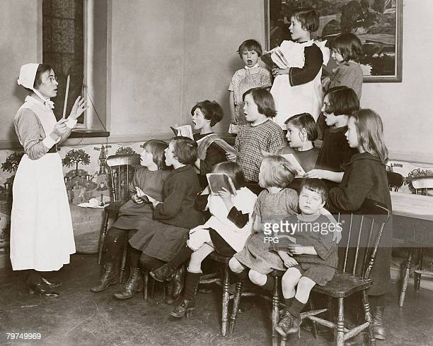 Children at a Barnardo's home for orphaned children in Barkingside Essex practising Christmas carols circa 1935