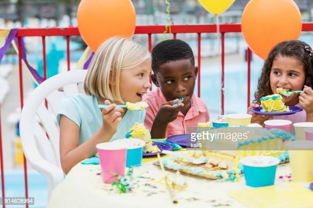 children at a birthday party eating cake - paper plate stock photos and pictures