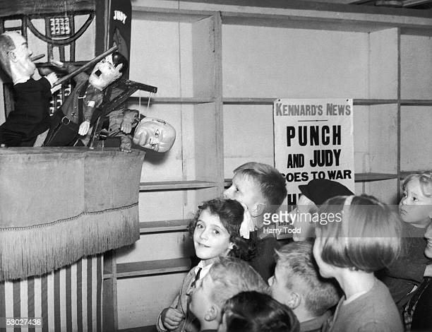 Children at a Croydon store watch a new kind of Punch and Judy show where the original characters have been replaced with lookalikes of Winston...