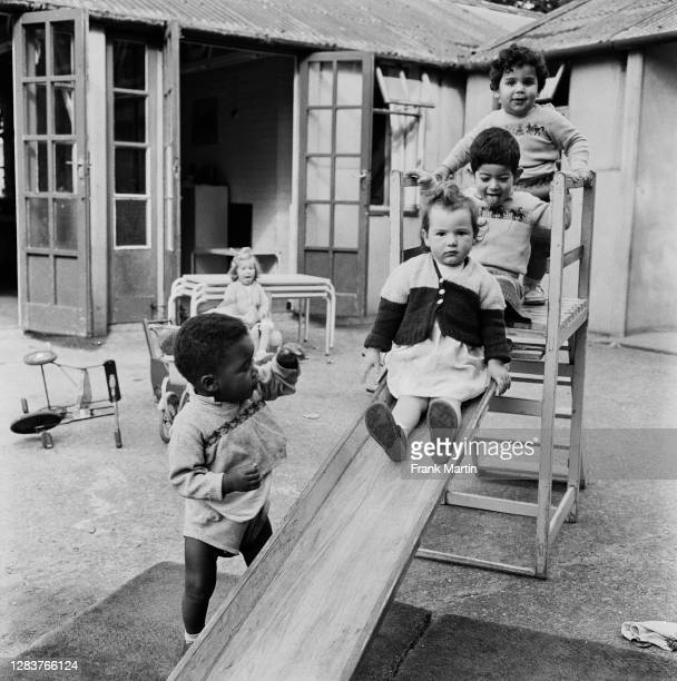 Children at a day nursery in the Notting Hill area of west London, circa 1958.