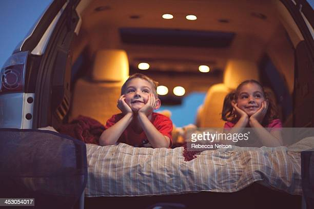 children at a drive-in movie - rebecca nelson stock pictures, royalty-free photos & images