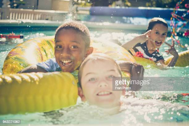 Children at a pool party.