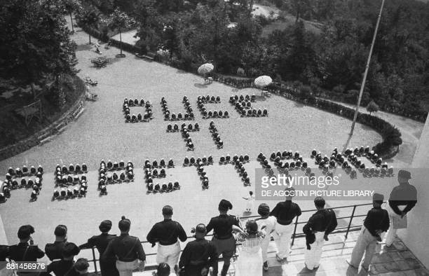 Children at a summer colony arranged to spell the words Duce we await you 19 July 1937 Genoa Italy 20th century