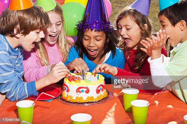 children at birthday party - birthday balloons stock photos and pictures