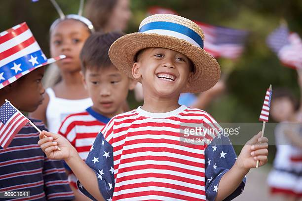 children at fourth of july parade - straw boater hat stock pictures, royalty-free photos & images