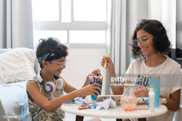children at home in the coronavirus quarantine - illness prevention stock pictures, royalty-free photos & images