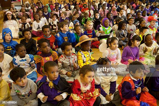Children at Kingsmead Primary School in Hackney enjoy their morning assembly on World Book Day They had all been asked to come to school dressed as...