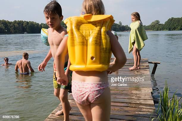 Children at lake in Trakai, Lithuania