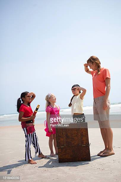 Children at pirate and princess party on beach