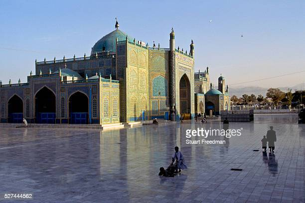 Children at play at the Hazrat Ali Mosque MazariSharif Afganistan The mosque also know as 'The Blue Mosque' is one of the reputed burial places of...