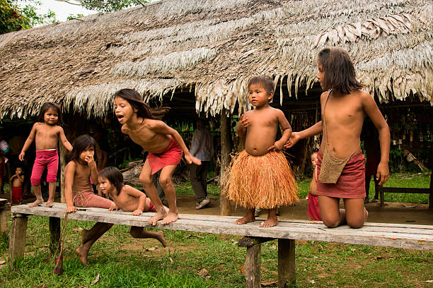 Children At Play In A Village On The Amazon River Peru