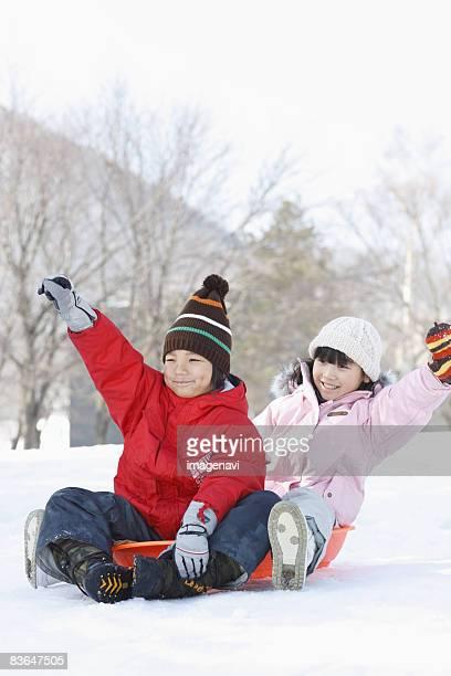 Children at play sledding