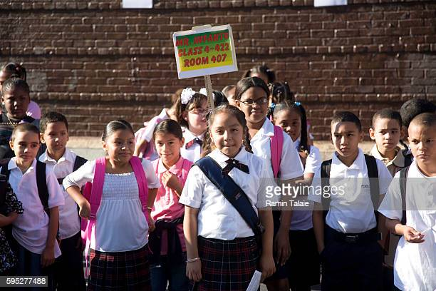 Children at Public School 53 in the Bronx borough of New York City gather in the school yard for the first day of school on Tuesday September 4 2007
