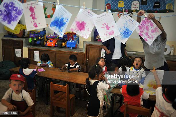 Children attend a class at the communal programme Futuro Vivo from the Carmelite Sisters of the Teaching in Guatemala City on March 24 2009 With its...