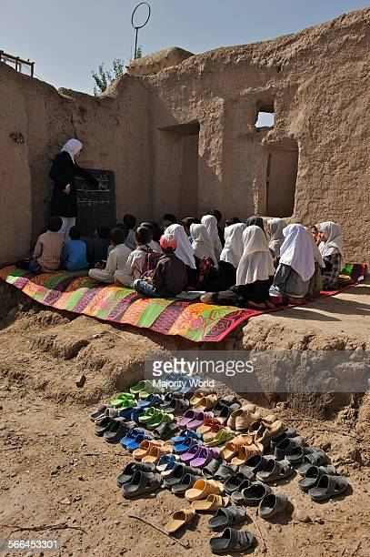 Children attend a class at the Community Based School in Qalae Haji Yahya village in Anjil district of Herat Province Afghanistan A total number of...