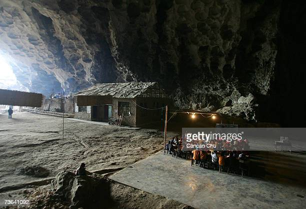Children attend a class at their school in a huge cave at a remote Miao village March 16 2007 in Ziyun county Guizhou province of southwest China The...