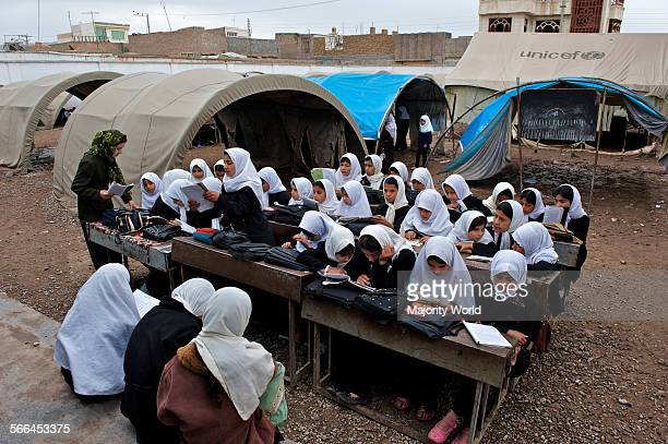 Children attend a class in the open at the government run PuleRangeena Primary School for girls in the northwestern city of Herat Afghanistan May 6...