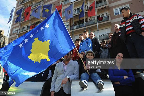 Children attend a parade as Kosovo celebrates its sixth anniversary of its declaration of independence from Serbia on February 17 2014 in Pristina...