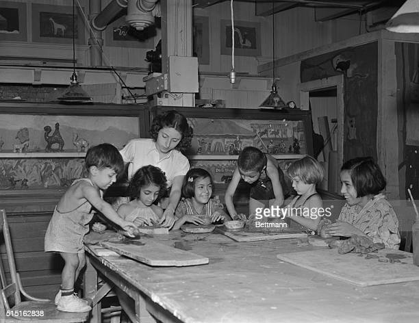 Children attend a pottery class at Jane Addams's HullHouse