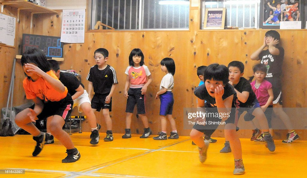 Children attend a training session at Isshi Junior Wrestling School where father of three-time Olympic gold medalist Saori Yoshida opened, on February 13, 2013 in Tsu, Mie, Japan. International Olympic Committee's decision to drop wrestling from 2020 Summer Olympic stuns Japan, as Japan won six medals in Wrestling including four gold at London Olympic.