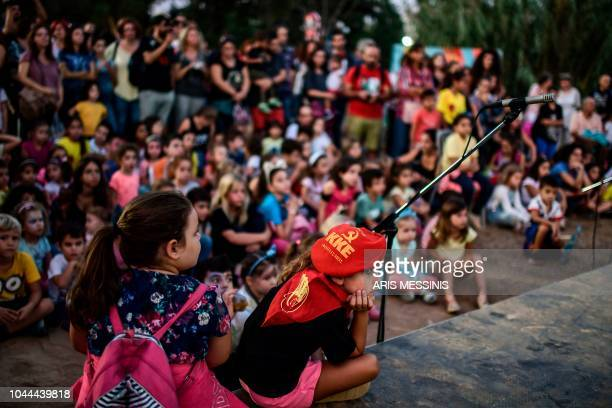 Children attend an annual festival of the Greek Communist party youth wing in Athens on September 22 2018 The Greek Communist party KKE turns 100...