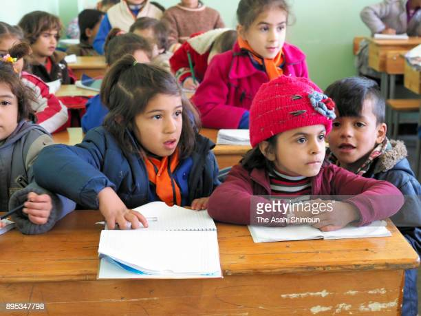 Children attend an Arabic lessen on December 12 2017 in Aleppo Syria Bashar alAssad administration backed by Russia recaptured the area in December...