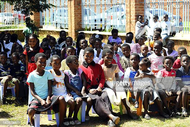 Children attend an Easter Sunday service at an outdoor church in Lilongwe on April 8 2012 Malawi's new President Joyce Banda was sworn in smoothly...