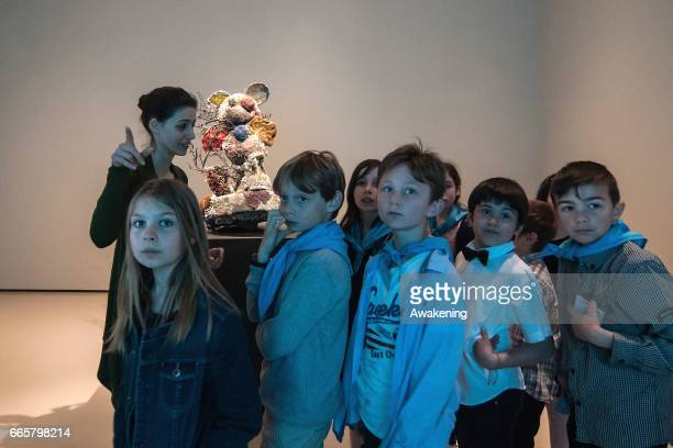 Children attend at the press preview of the Damien Hirst's new exhibition 'Treasures From The Wreck Of The Unbelievable' is seen at Punta della...