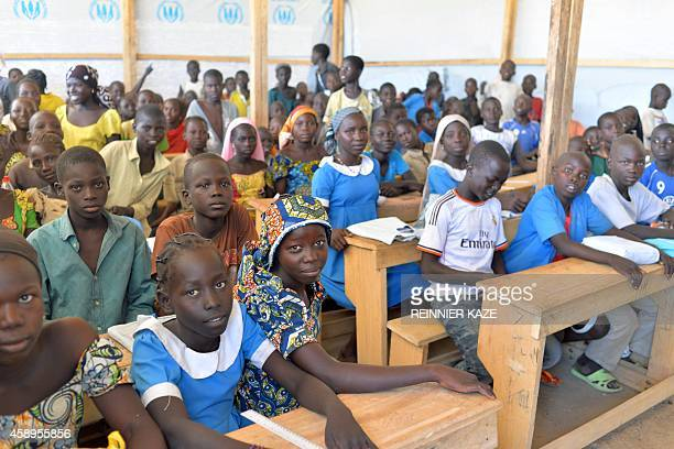 Children attend classes on November 13 2014 in a UNHCR camp for Nigerian refugees in Minawao in the extreme northwest of Cameroon Almost 17000...