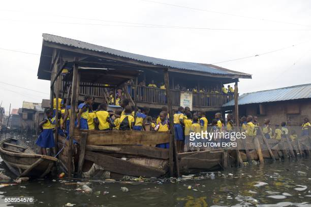 Children attend school in the main site of a floating school near to a collapsed threestorey annex on June 9 2016 in Lagos A landmark floating school...