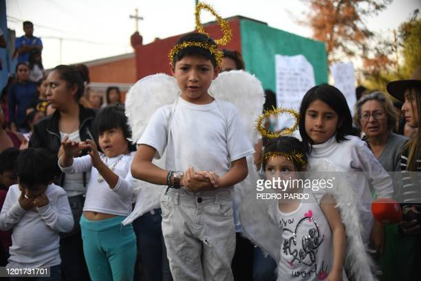 Children attend the burial of a sevenyearold girl whose body was found over the weekend with signs of torture at a cemetery in Mexico City on...