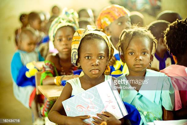 Children attending a newly built school classroom in a remote village in Mali.