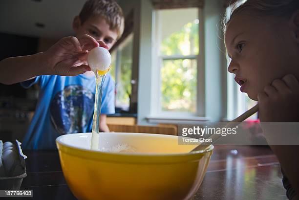 Children Baking and Cracking an Egg