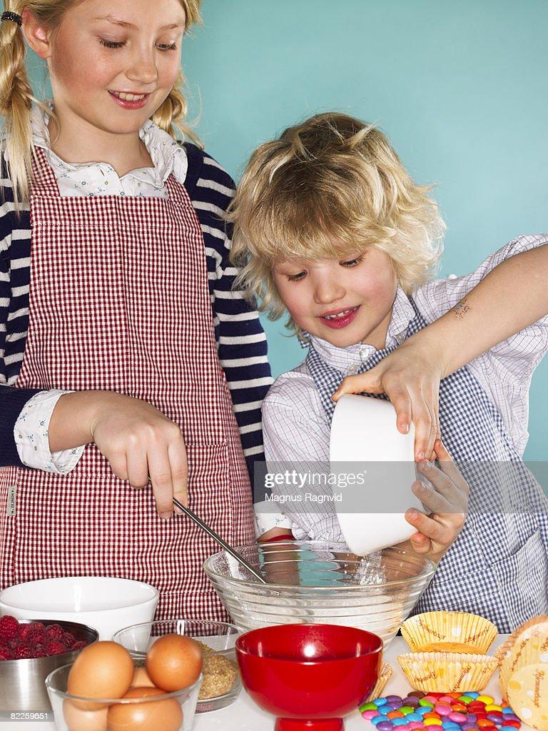 Children baking cakes Denmark. : Stock Photo