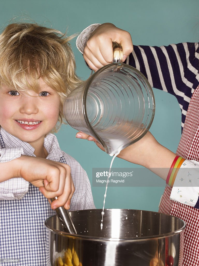 Children baking cakes Sweden. : Stock Photo