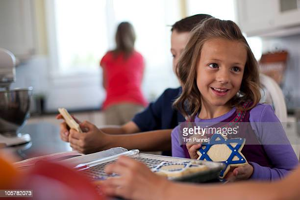 children baking cookies - hanukkah stock pictures, royalty-free photos & images
